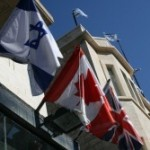 Israel and Canadian flags in Jerusalem. Photo by Joshua Spurlock.