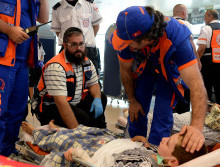 Israeli medics help wounded Gazans. Photo courtesy of Israel GPO. By Kobi Gideon / GPO.