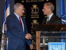 A handshake across the world. Israeli PM Netanyahu & Danish Ambassador Jesper Vahr. Illustrative. Photo courtesy of Amos Ben-Gershom (GPO)